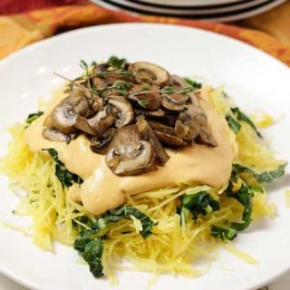 Roasted Spaghetti Squash w/ Mushrooms, Greens & Vegan Cashew Cheese Sauce