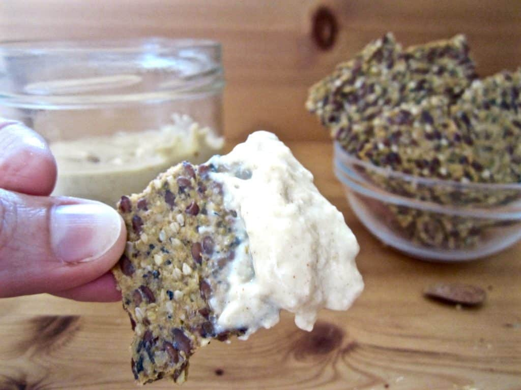 Super simple spicy almond cheese - use as a spread on crackers or as a sauce in common dishes like nachos, pizzas and pastas. Vegan, gluten free, soy free + paleo | veganchickpea.com
