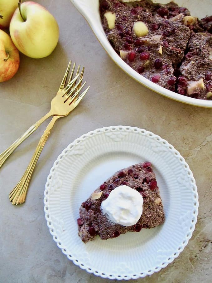 Autumn Apple & Pomegranate Chia Pudding Slice recipe - a healthy and easy breakfast or snack (12.5g of protein/slice), served warm or cold with coconut whipped cream and almond butter! Vegan, gluten free, paleo, refined sugar free with 100% sugar free and raw options!   veganchickpea.com