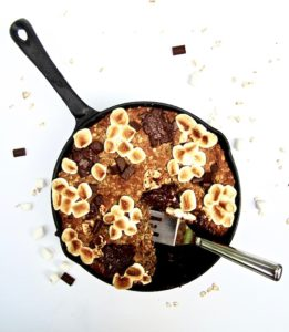 S'mores Oatmeal Cookie Skillet Cake recipe - This vegan and gluten free thick cookie cake is a hybrid between oatmeal bars and cookies, with chocolate chunks, marshmallows, oats, coconut flour and flavorful hints of cinnamon, nutmeg and ginger. A new spin on an old classic, perfect for summer or anytime of year!   veganchickpea.com