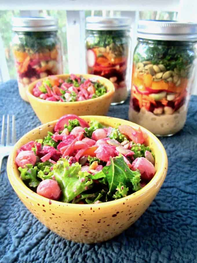 This colorful and nutritious Massaged Kale Salad is loaded with raw veggies, chickpeas and a Chili Vegan Ranch Dressing. Mason jars containers make for a convenient, grab-and-go option for an easy make ahead lunch recipe! {vegan, GF} | veganchickpea.com