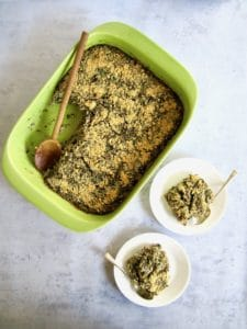 This healthy Spinach & Artichoke Quinoa Casserole recipe (gluten free) unites the classic combo of Spinach & Artichoke Dip with an American family favorite - the hearty casserole! Using organic truRoots quinoa, this recipe makeover is filled with plant based protein and delivers a vegan meal that the whole family will enjoy out of the oven or for leftovers the next day. | veganchickpea.com
